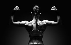 Athletic young woman showing muscles of the back Stock Photo