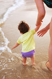 Attending baby on sea shore Stock Photo