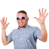 Attractive adult man with beard wearing sunglasses in summer shirt delighted Royalty Free Stock Photography