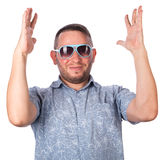 Attractive adult man with beard wearing sunglasses in summer shirt delighted Stock Photo