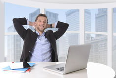 Attractive businessman happy at work smiling relaxed at computer business district office Royalty Free Stock Images