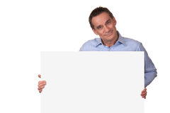 Attractive Man Holding Blank White Sign Royalty Free Stock Photos