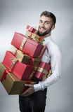 Attractive man with many present boxes in his arms Stock Photography