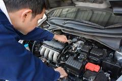 Auto mechanic fixing car Stock Photo