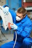 Auto mechanic polishing car body Stock Photo