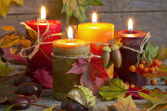 Autumn candles with leaves vintage abstract still life Stock Image