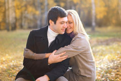 Autumn, love, relationship and people concept - happy couple Stock Image