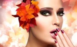 Autumn Makeup and Nail Art Trend. Fall Beauty Fashion Girl Stock Photos