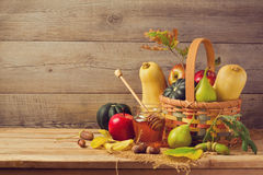 Autumn nature concept. Fall fruits and pumpkin on wooden table. Thanksgiving dinner Stock Photo