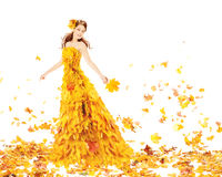Autumn woman in fashion yellow dress of maple leaves Stock Photo