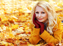 Autumn Woman with Maple leaves. Blonde Beautiful Girl in Fall Stock Photo