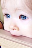 Baby Biting on Crib - Closeup Royalty Free Stock Image