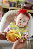 Baby Eating Solid Food Stock Photo