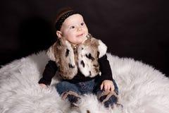 Baby in fur coat Royalty Free Stock Photo
