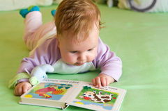 Baby girl reading book Royalty Free Stock Photo