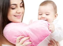 Baby and mama with heart-shaped pillow Royalty Free Stock Photo