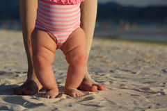 Baby and parent feet on sand beach Royalty Free Stock Image