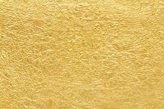 Bakgrundstextur för guld- folie Arkivfoto