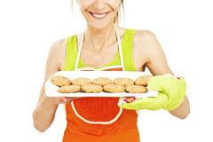 Baking woman showing cookies on tray Royalty Free Stock Photos
