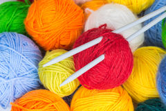 Balls of wool yarn and knitting needles Royalty Free Stock Photo