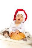 Bambino felice del cuoco unico con pane Immagine Stock Libera da Diritti