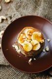 Banana cashew pancakes with bananas and salted caramel sauce Royalty Free Stock Photo