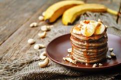 Banana cashew pancakes with bananas and salted caramel sauce Stock Photo