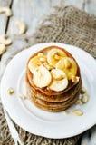 Banana cashew pancakes with bananas and salted caramel sauce Royalty Free Stock Photos