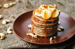 Banana cashew pancakes with bananas and salted caramel sauce Royalty Free Stock Images