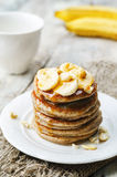 Banana cashew pancakes with bananas and salted caramel sauce Royalty Free Stock Photography