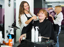 Barber makes the cut for  woman Stock Image