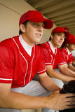 Baseball Team Mates Sitting In Dugout Royalty Free Stock Photos
