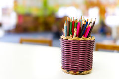 Basket of colourful kids pencils Stock Photography