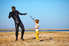 Battle between boy and black man Stock Image