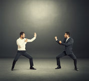 Battle between two businessmen Royalty Free Stock Photo
