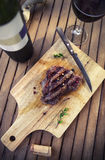 BBQ steak. Barbecue grilled beef steak meat with red wine and kn Stock Photos