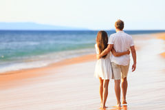 Beach couple walking on romantic travel Stock Photo