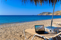 Beach with laptop Royalty Free Stock Images