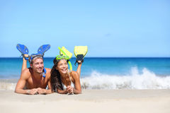Beach travel couple having fun snorkeling looking Stock Image
