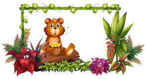 A bear above a trunk in the garden Stock Images