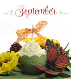 Beautiful Autumn Fall theme cupcake with autumn seasonal flowers and decorations for the month of September Stock Images