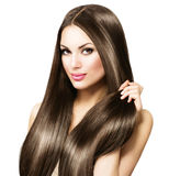 Beautiful brunette woman touching her long hair Royalty Free Stock Photography