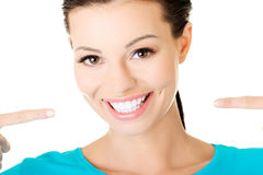 Beautiful casual woman showing her perfect white teeth. Royalty Free Stock Photography