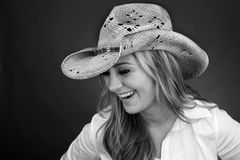 Beautiful Cowgirl laughing Royalty Free Stock Images