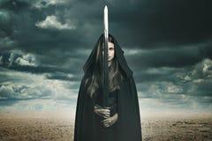 Beautiful dark woman in a desert landscape Stock Photos
