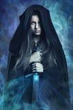 Beautiful dark woman and magic powers Stock Images