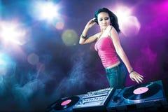 Beautiful DJ girl at the club Stock Photo