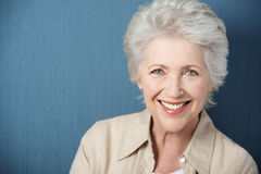 Beautiful elderly lady with a lively smile Stock Images