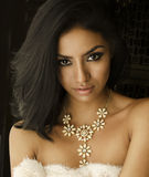 Beautiful exotic young woman necklace Royalty Free Stock Images
