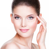 Beautiful face of young woman with cosmetic foundation on a skin Royalty Free Stock Photos
